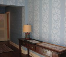 blue walls with lighter blue floral stencil in a 2 story foyer