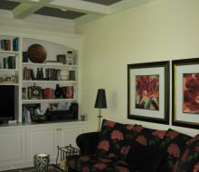Family room with darkly painted coffered ceiling with white beams