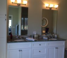 bathroom vanity with white painted cabinets