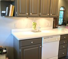 gray painted oak kitchen cabinets with silver hardware
