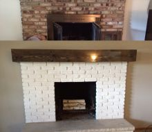 white painted brick on fireplace and gray walls