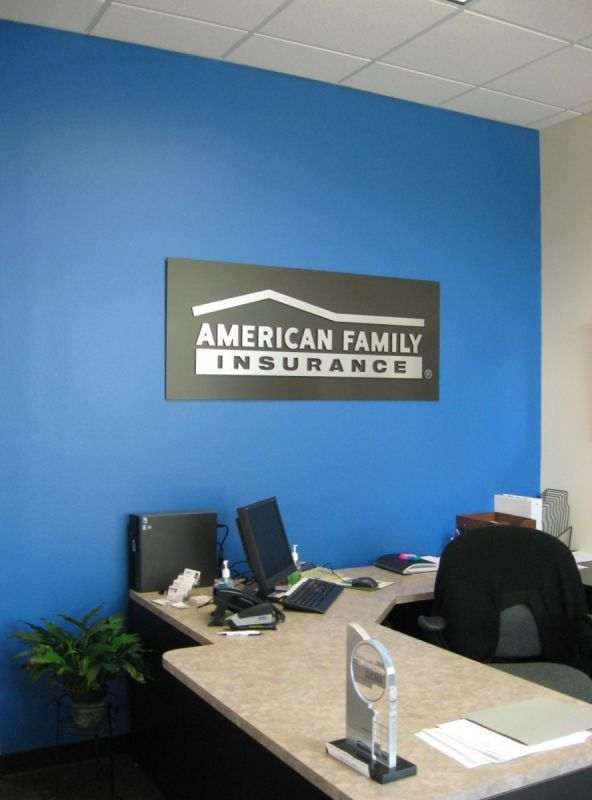 office blue. Of American Family Insurance Office. Blue And Gray Walls With Business Logo. Office