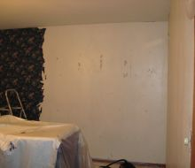 dark blue floral wallpaper removed from half the walls in this Dining room