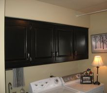Black painted laundry room cabinets