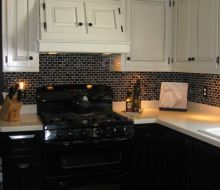 white upper kitchen cabinets and black lower cabinets