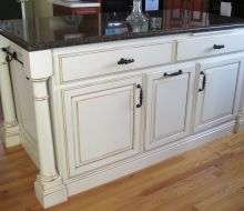 White painted kitchen island with black top