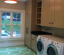 laundry Room with light green floors and white circle stencil design