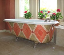 decoratively painted salmon, green and cream clawfoot tub