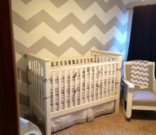 Nursery with white and gray chevron pattern