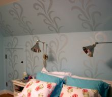 Bedroom with blue walls and silver stencil design