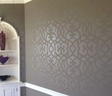 tone on tone stencil design on greenish walls