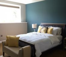 Bedroom with gray and blue walls