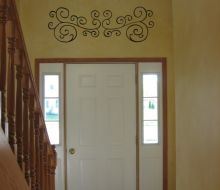 imitation wrought iron design painted over a decorative finish in 2 story foyer