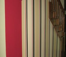 Red, beige and black stripes on foyer walls