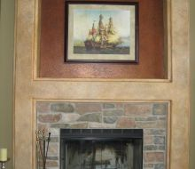 Feild stone fireplace with brown & green decorative finish and crackle finish over fireplace