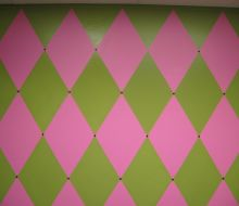 Pink and Green harlequin design on wall